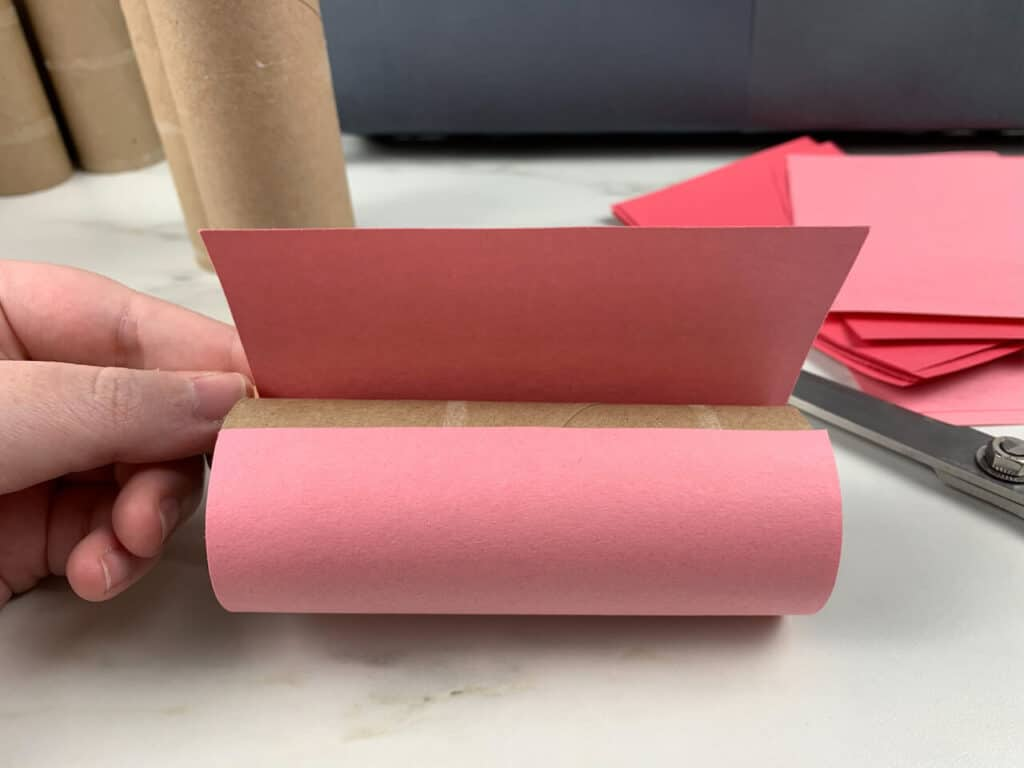 Toilet paper roll wrapped in construction paper for a valentines day advent calendar