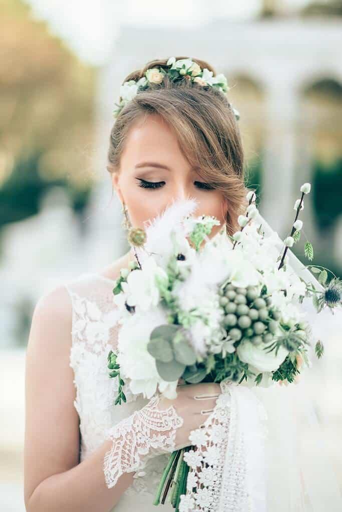 Bride Walking Down Aisle Smelling Flowers