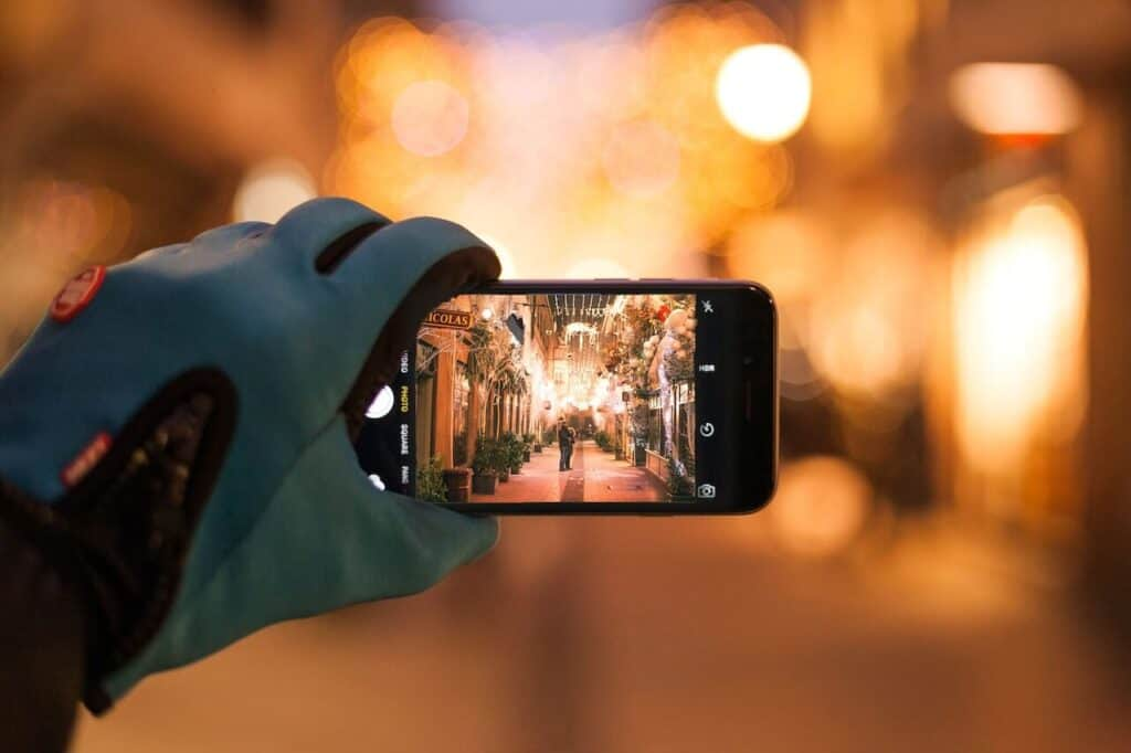 Man holding phone taking a photo