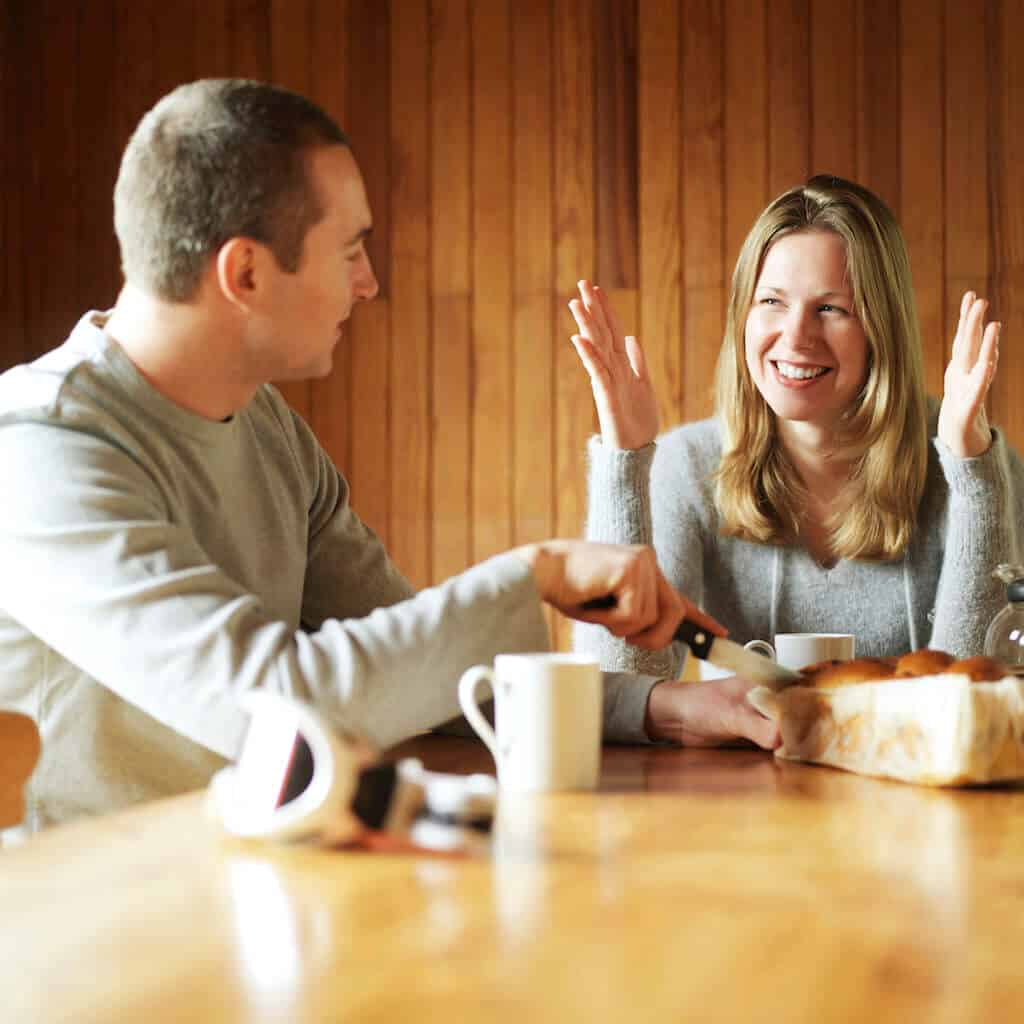 couple talking at table doing communication exercises
