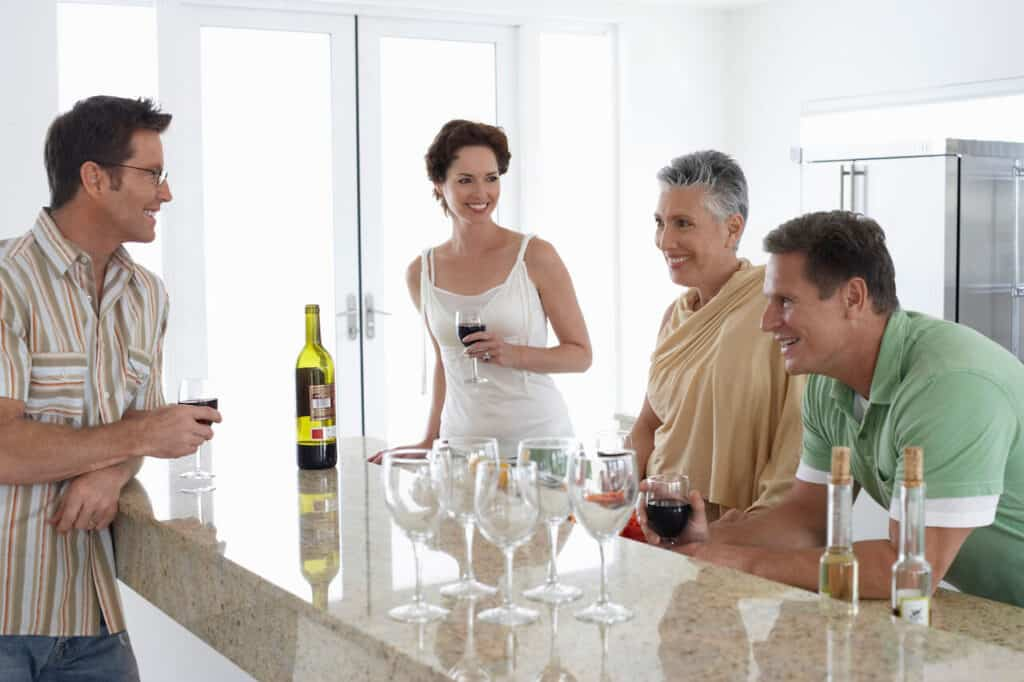 2 couples drinking wine at home
