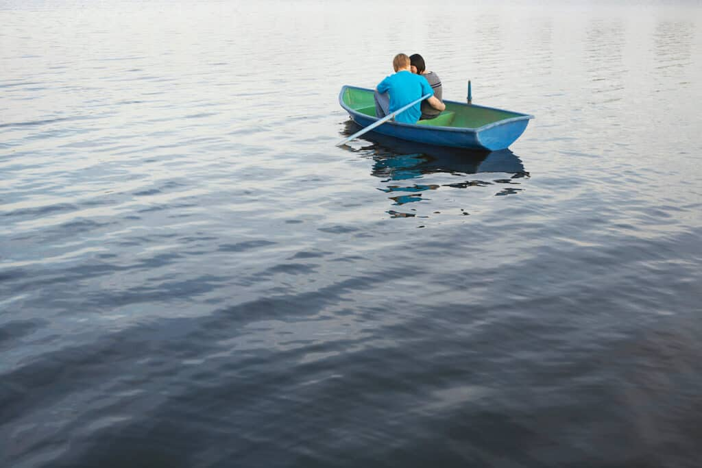 Couple riding in a boat