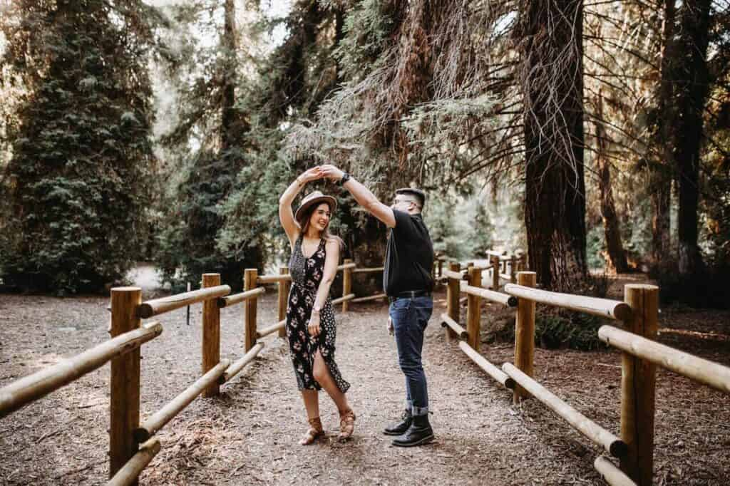 couple dancing while on a hike for a summer activity