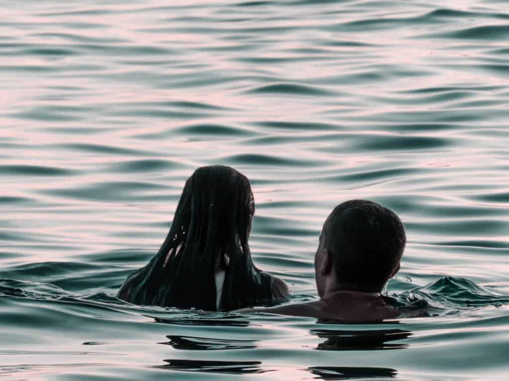couple swimming in water for a summer activity
