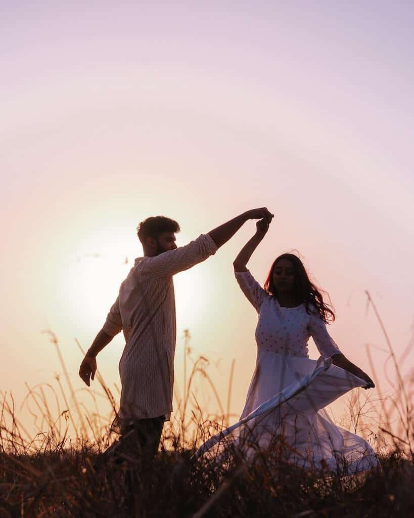 couple dancing in the field