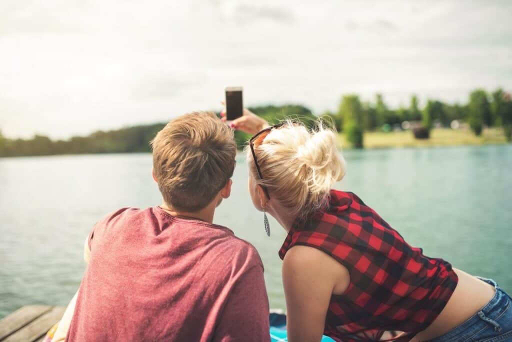 couple taking a picture at the lake