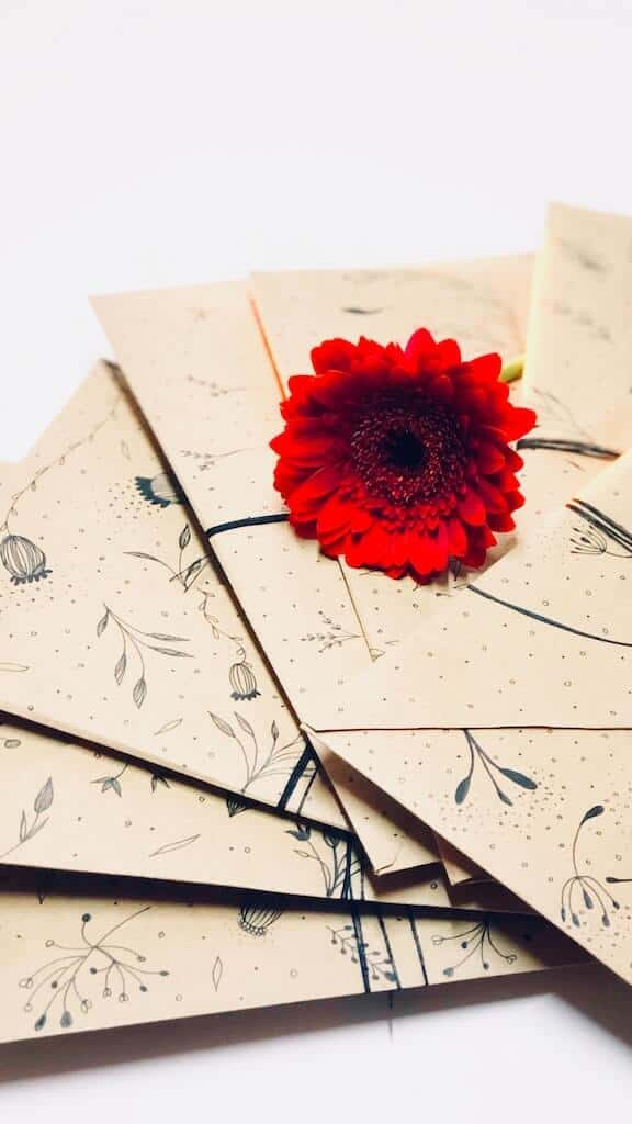 envelopes with flower on top