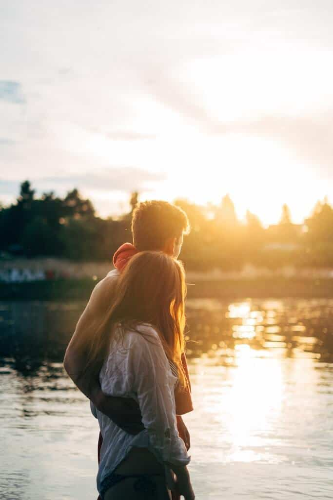 couples at lake watching the sunset for a summer bucket list check
