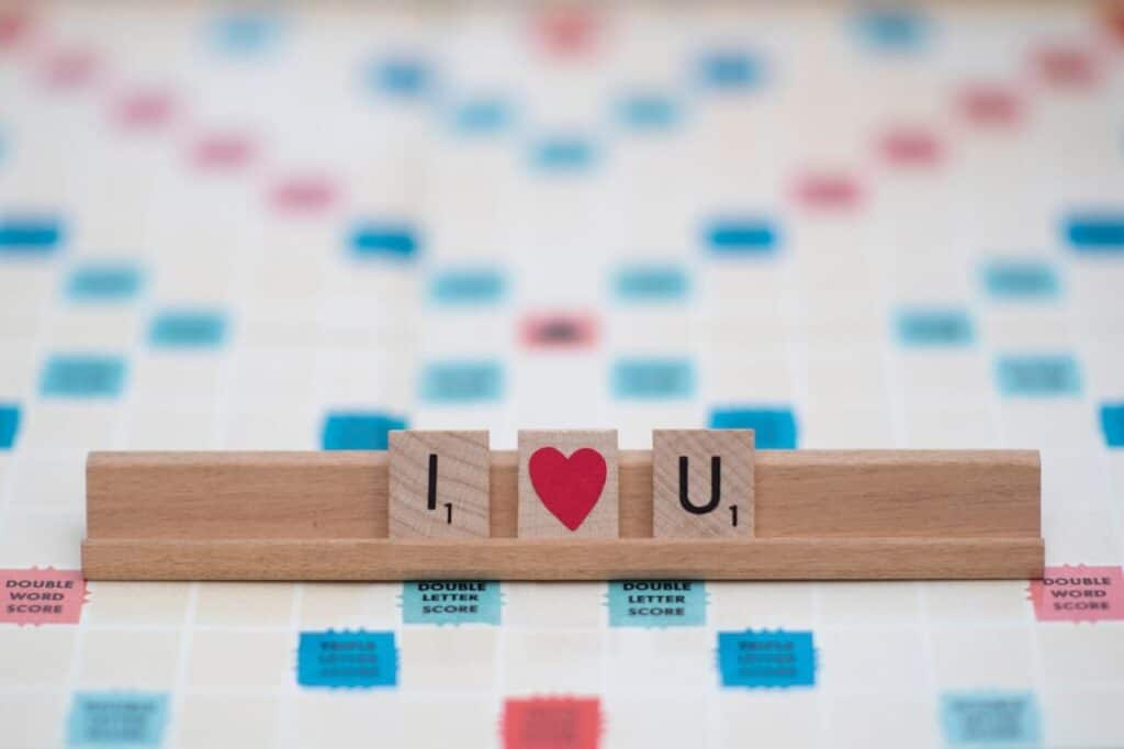 "Scrabble pieces spell ""I (heart) U"" for games for couples"