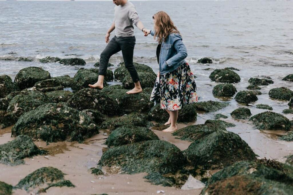 couple going tide pooling for an outside date