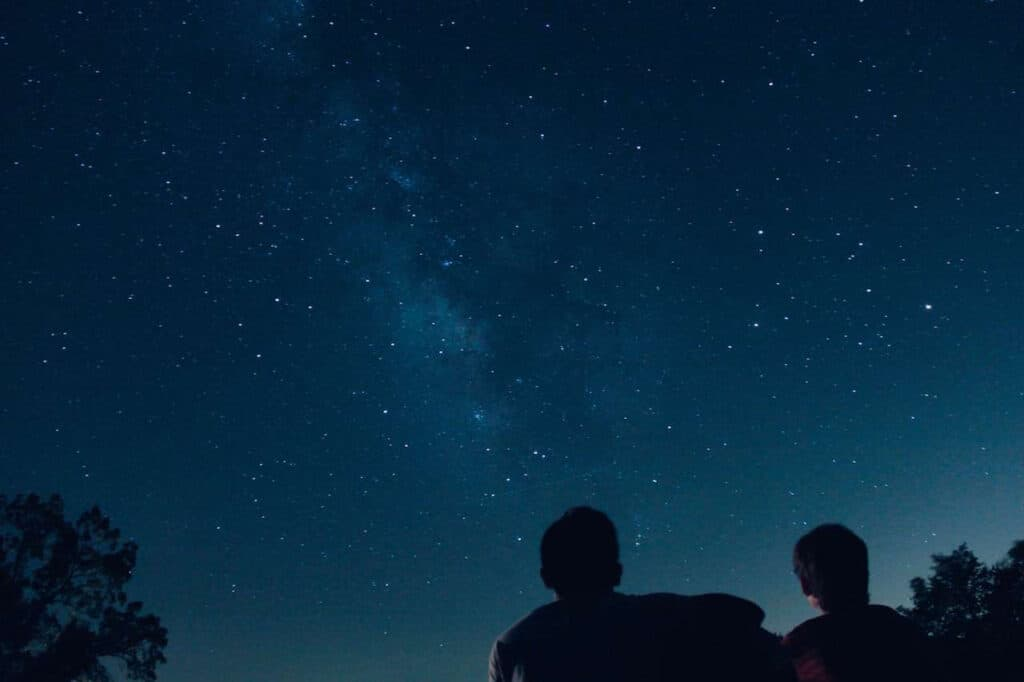 couple looking at the stars for at home dates