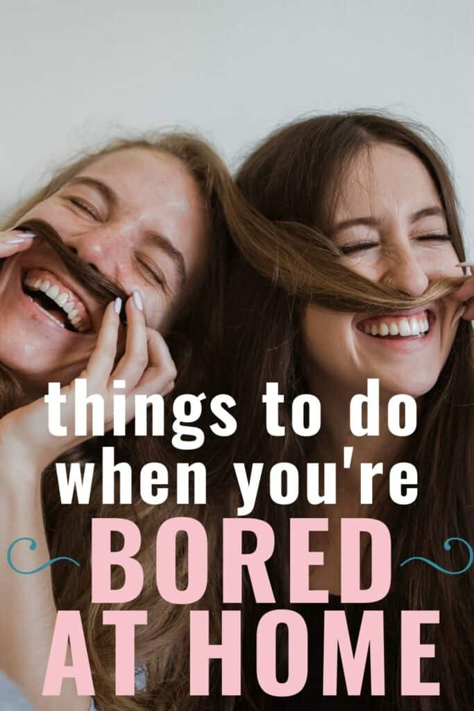 two girls laughing playing with hair mustache text reads things to do when you're bored at home