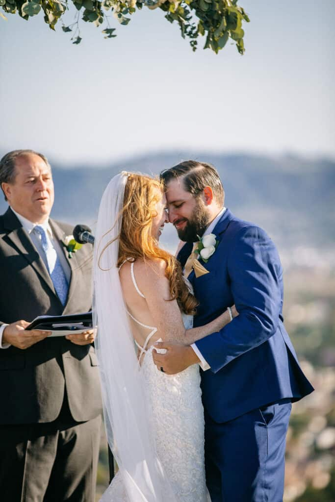 bride and groom smiling with foreheads touching