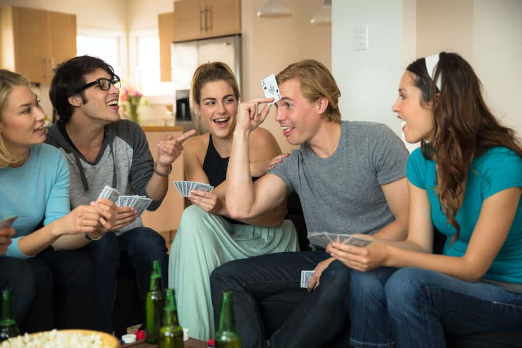double date couples playing a card game