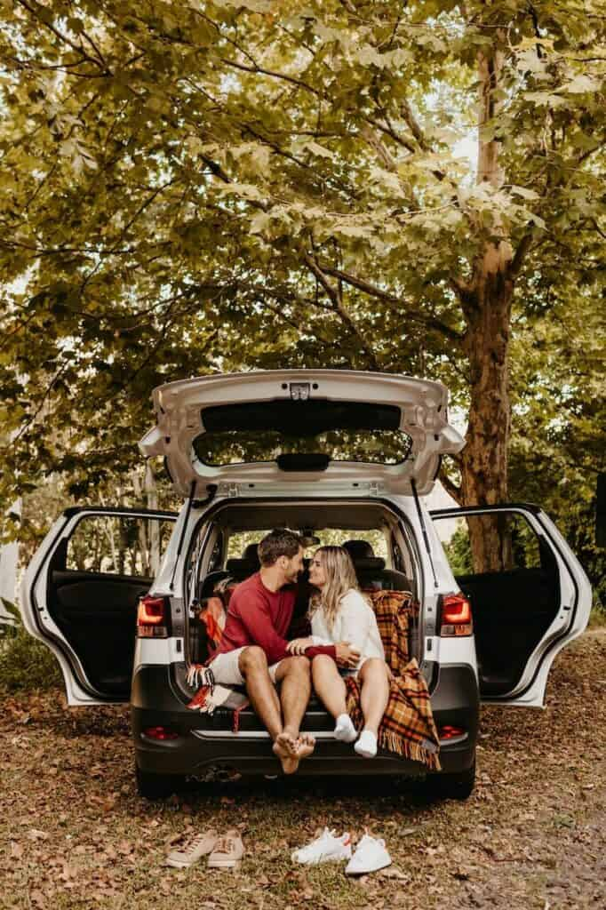 couple sitting in back of car on a date