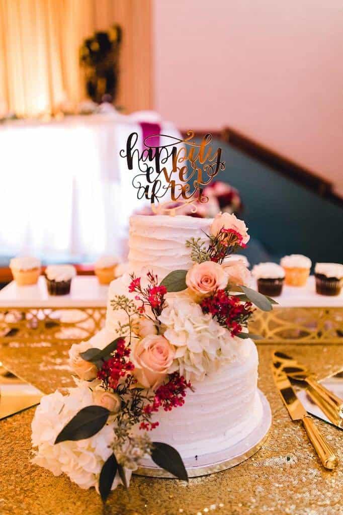 Sam's Club Wedding 3 tiered Cake with flowers around it