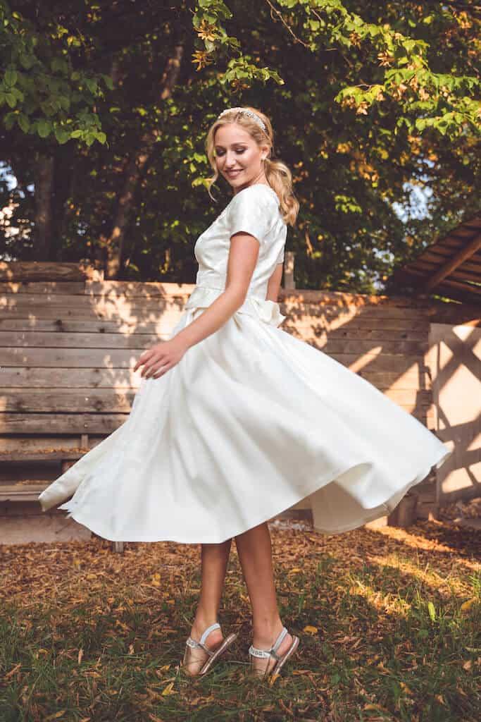 Woman twirling in a white dress