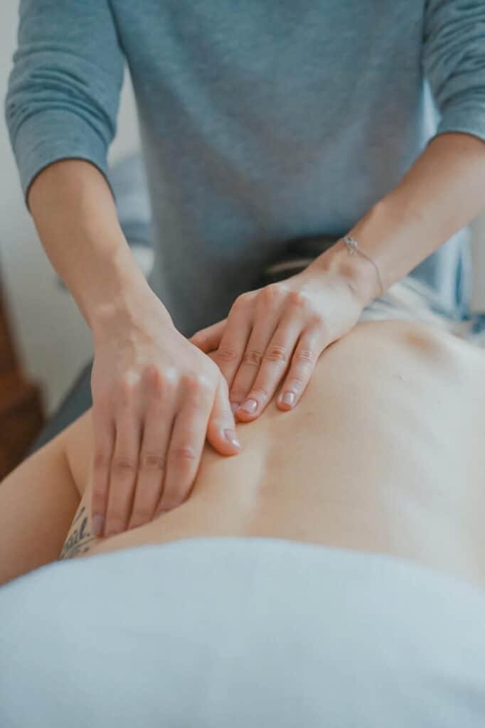 hands massaging back