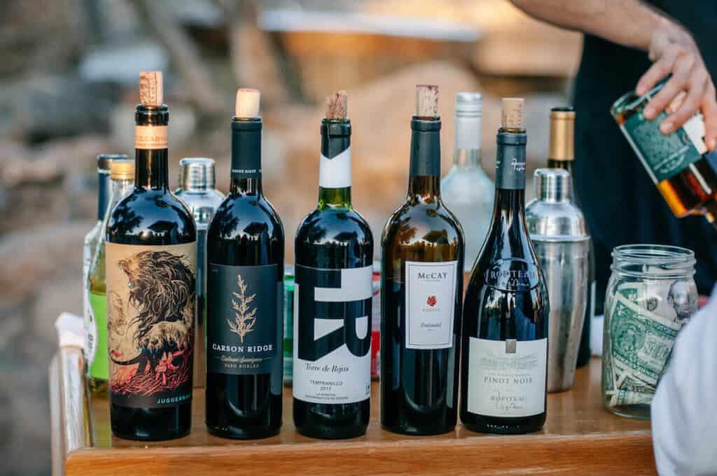 wine bottles on a bar at wedding