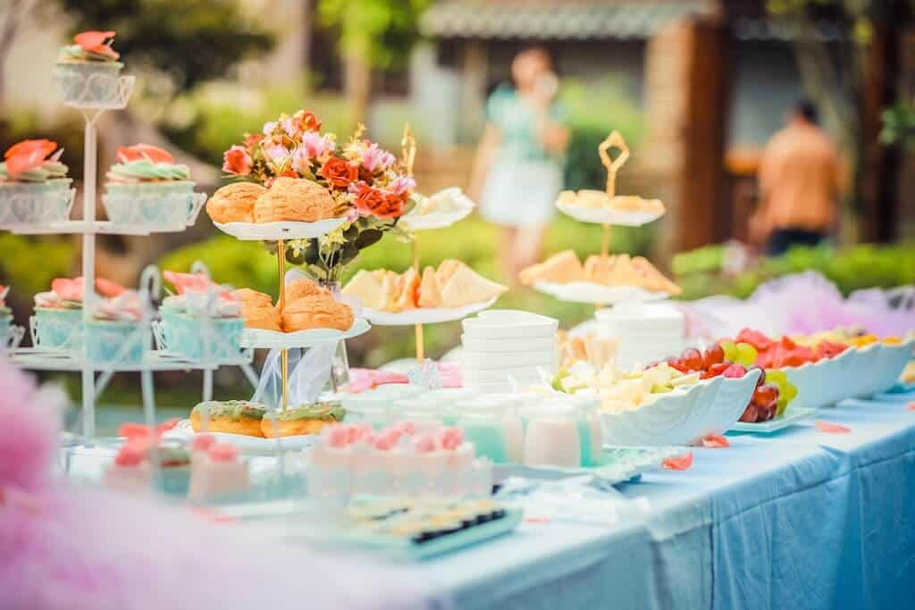 table full of finger foods and desserts