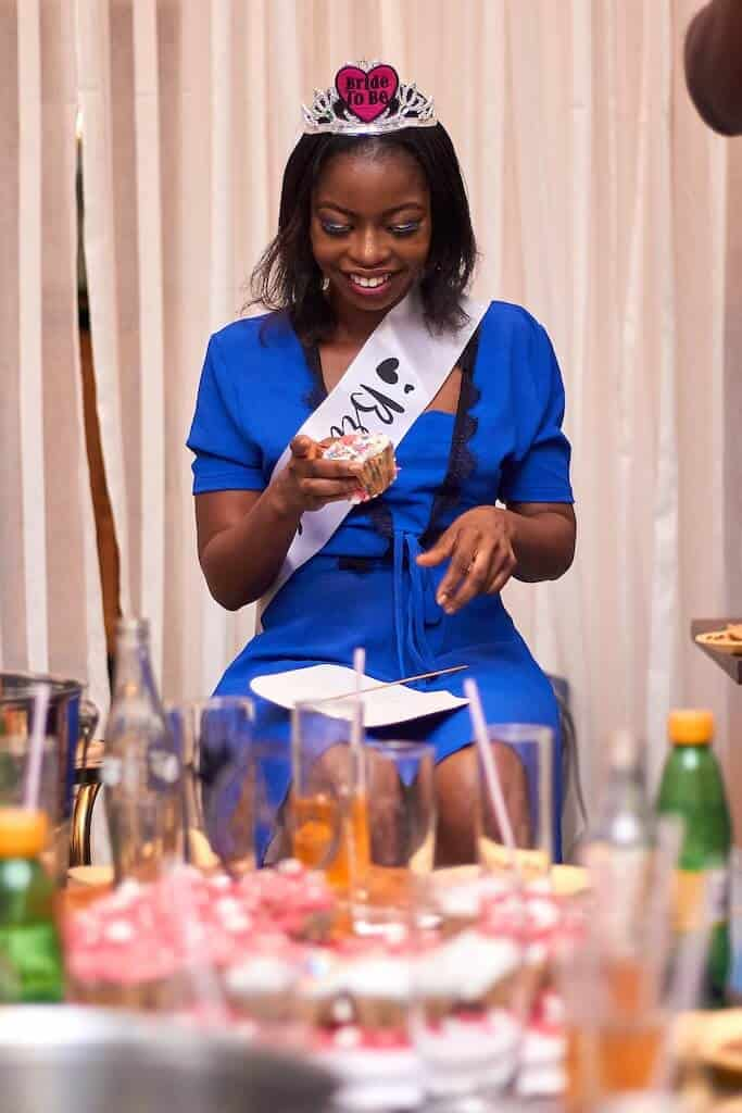 Bride-to-be opening gifts at bridal shower
