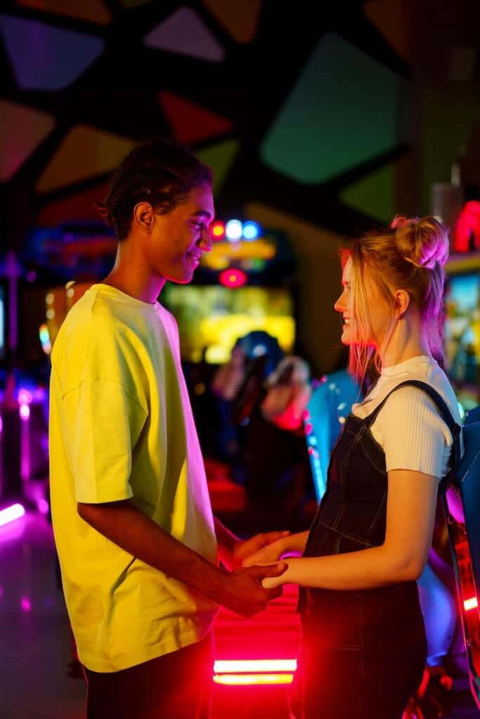 couple holding hands at an arcade
