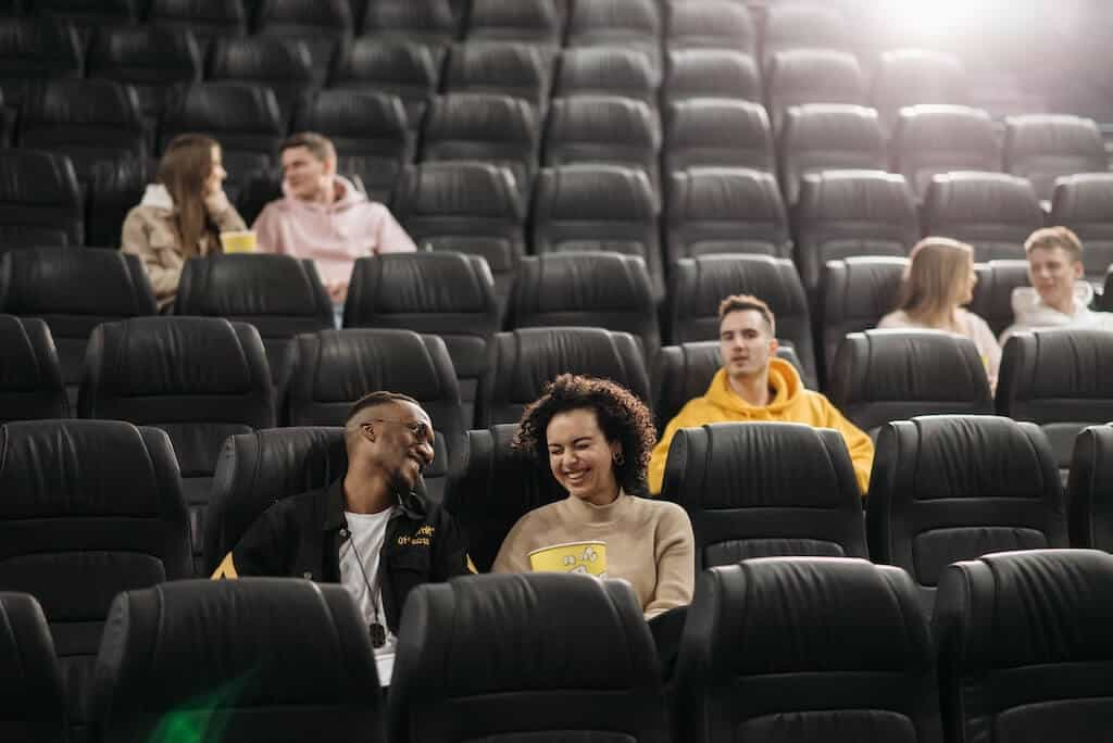 couple laughing together in movie theater